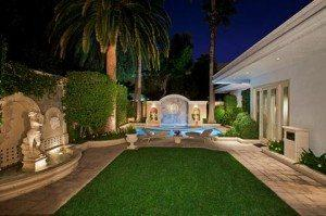 Your own private backyard with putting green and pool.